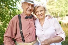 Elderly couple looking at camera in natural environment in summer Stock Photos