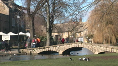 Cotswolds England idyllic scene in traditional english village - stock footage