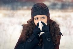 Woman with Tissue Outside Feeling Bad Cold Winter - stock photo