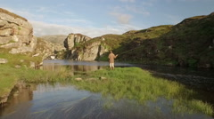 Aerial shot on the Isle of Harris infront of a fly fisherman Stock Footage