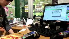 Close up credit card payment terminal printing receipt Stock Footage