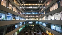 Cinemagraph Time lapse of busy city office workers together in large modern Stock Footage