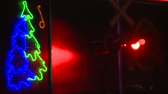 Stock Video Footage of Winter night, holiday train night inbound CU, crossing lights flashing