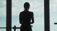 The woman shows muscles in fitness hall Stock Footage