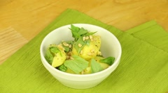 Boiled potatoes with pine nuts and basil Stock Footage