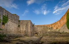 Old fortress walls and blue sky view - stock photo