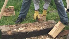 Lumberjack loading wood logs to wheelbarrow Stock Footage