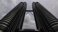 A cloudy time-lapse of the Petronas Towers in Kuala Lumpur, Malaysia Stock Footage
