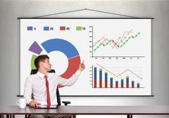 businessman showing a business charts - stock photo