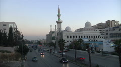 Traffic and mosque Amman city Jordan Stock Footage