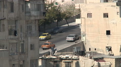 Houses and traffic Amman city Jordan Stock Footage