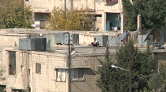 Man calling on a roof in Amman city Jordan Stock Footage