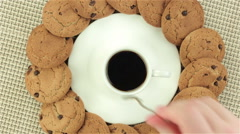 Mixing coffee and taking cookie Stock Footage