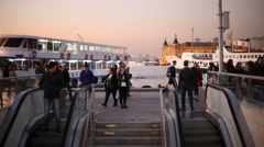 People walk around the pier Stock Footage