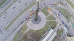 Monument of Yuriy Gagarin near road with transport traffic Stock Footage