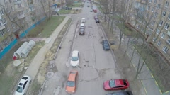 Many cars parked on street under construction near dwelling houses Stock Footage
