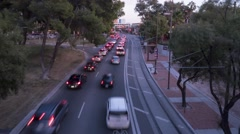 City traffic passing under a bridge - Tucson Stock Footage