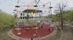 Tall Rope Park Skytown with many young people at spring Stock Footage