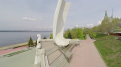 Monument Ladya on embankment at spring sunny day Stock Footage