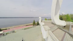 Quay with monument Ladya at spring sunny day. Aerial view Stock Footage