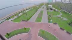 Embankment with people walk near Monument at spring Stock Footage