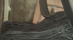 Harris tweed being produced in a local mill after being washed Stock Footage