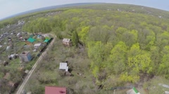 Cottage settlement among plants at spring sunny day. Aerial view Stock Footage