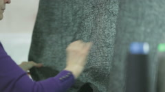 Harris tweed fabric being checked for quality - stock footage