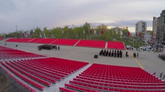 Rows of soldiers march between empty tribunes at spring Stock Footage