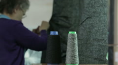 Harris tweed fabric being checked for quality Stock Footage