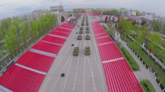 Armoured units drive along empty tribunes at spring Stock Footage