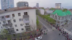 Citizens walk by streets during parade rehearsal at spring Stock Footage