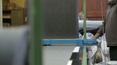 Harris tweed fabric being processed and rolled up in a local mill Stock Footage