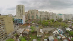 Transport traffic on street with tall and small dwelling houses - stock footage
