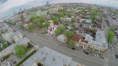 Traffic near church and edifice of State Philharmonic of Samara Stock Footage