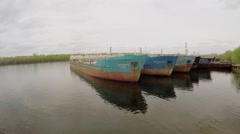 Several tankers on moorage in Volga river at spring cloudy day. Stock Footage