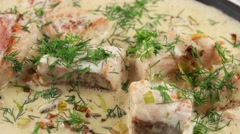 Fish soup with salmon, cream and parsley Stock Footage