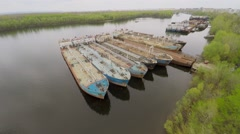 Moorage with few oil carriers in Volga river and city on horizon Stock Footage