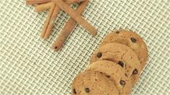 Cookies and cinnamon on napkin - stock footage