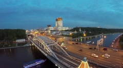 Passengers vessels sails near Novoandreevsky bridge with traffic Stock Footage