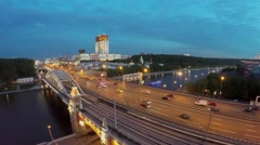 Cityscape with transport traffic on Novoandreevsky bridge at spring Stock Footage