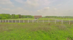 Fenced territory of Federal Memorial Cemetery at spring Stock Footage