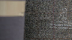 Harris Tweed orb authority stamped on Harris Tweed fabric - stock footage