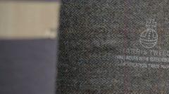 Harris Tweed orb authority stamped on Harris Tweed fabric Stock Footage