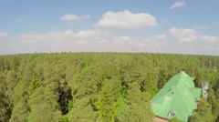 Residential building among forest at summer day. Aerial view Stock Footage