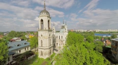 Church of Icon of Mother of God near dwelling houses and cityscape Stock Footage