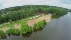 South beach of Malahovskoe lake near forest at summer Stock Footage