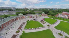 People walk near entrance gate to territory of Tsaritsino park Stock Footage