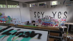 An abandoned classroom full of graffiti - stock footage