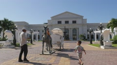Father makes photo of kids at city hall,Phnom Penh,Cambodia Stock Footage